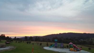 sunset over the playground at Karri Aura